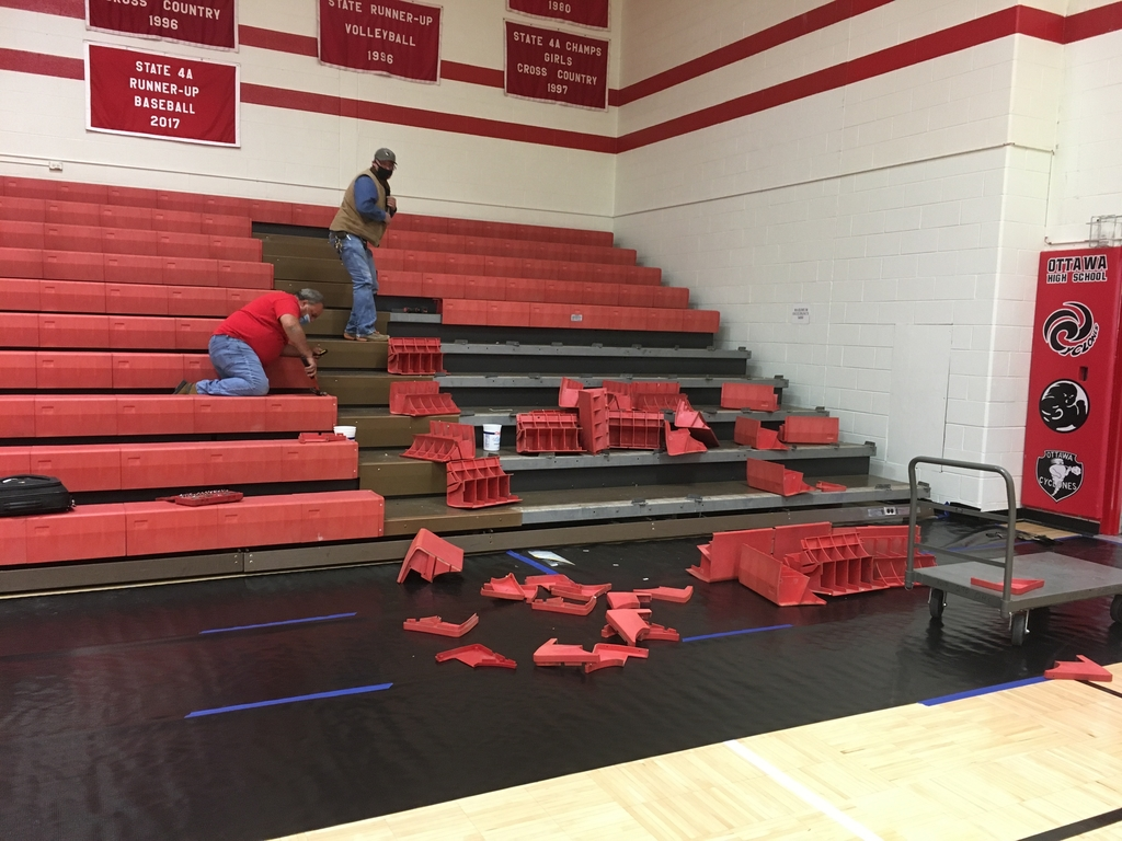 Guy tearing out old bleachers