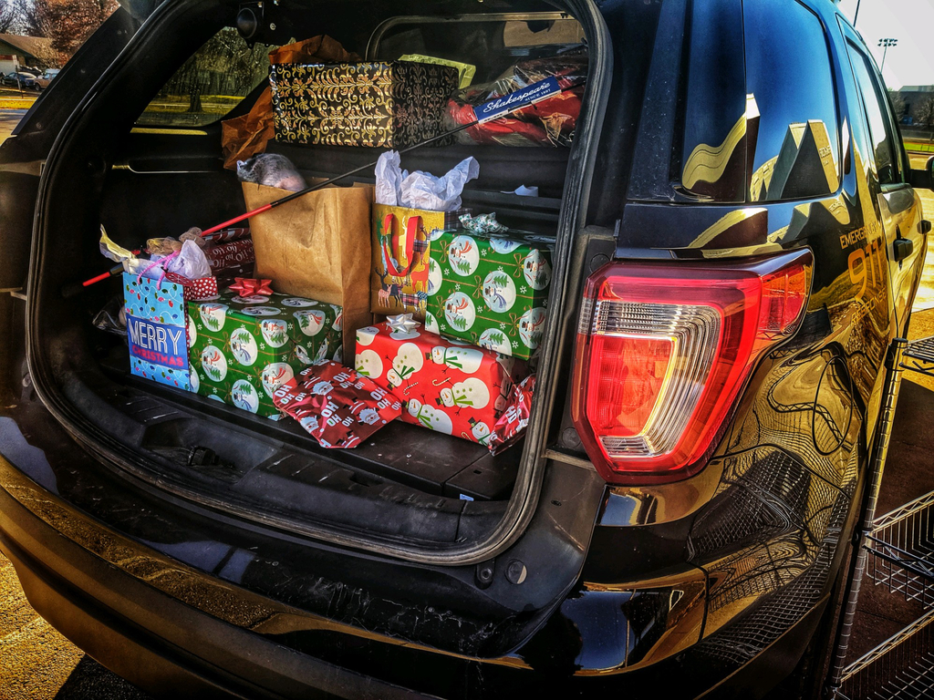 Presents in the back of a police car.
