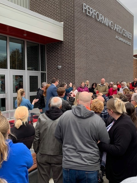 USD290 Stakeholders gather for the official ribbon cutting at the Performing Arts Center at Ottawa High School