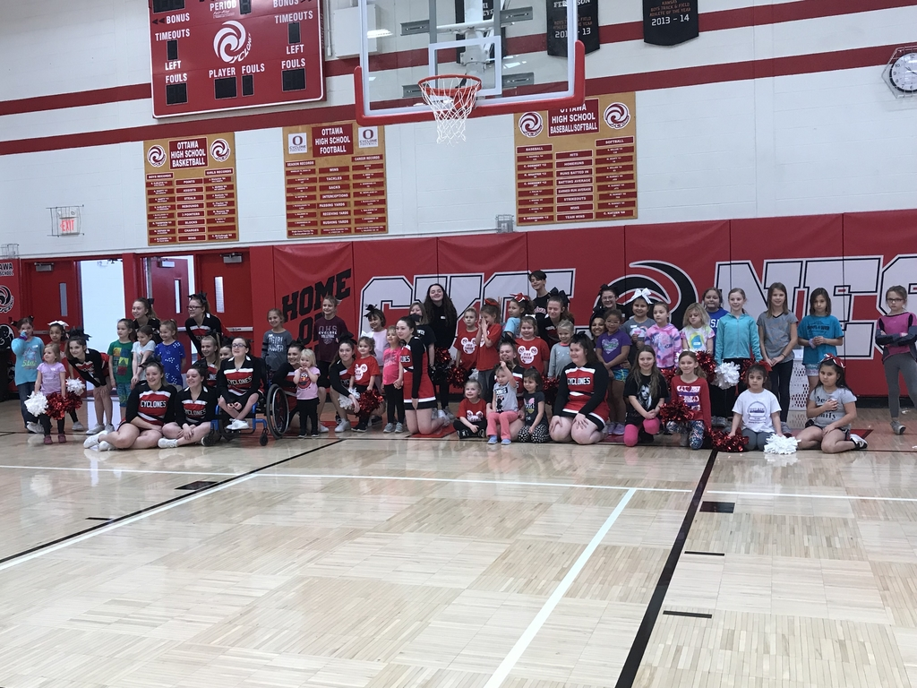 Cheerleaders with kids who participated in camp.