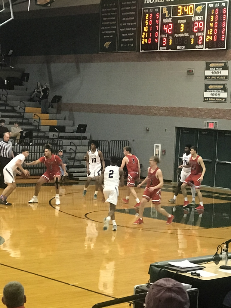 Boys basketball playing Piper.