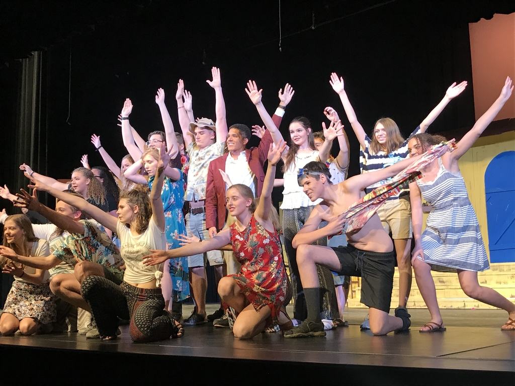 Students posing at the end of a musical