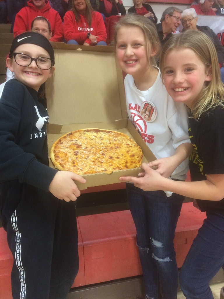 Kids posing with pizza