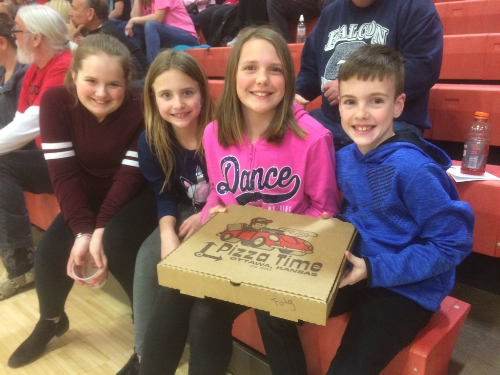 Kids holding a pizza