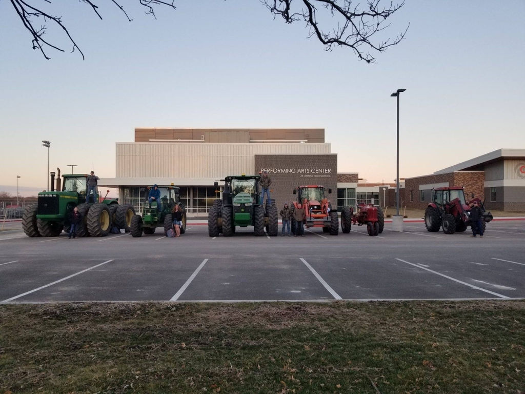 Tractors parked in front of school