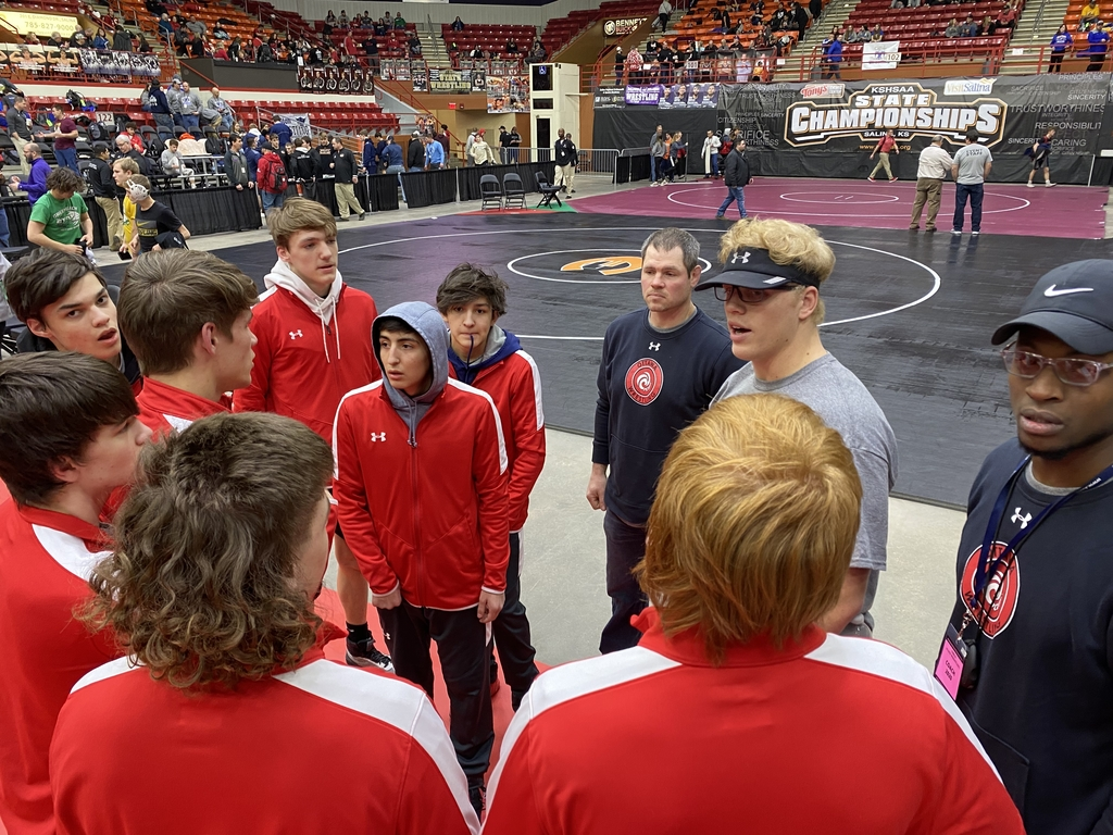Coach Weidl gives the prematch pep talk before the days competition begins.