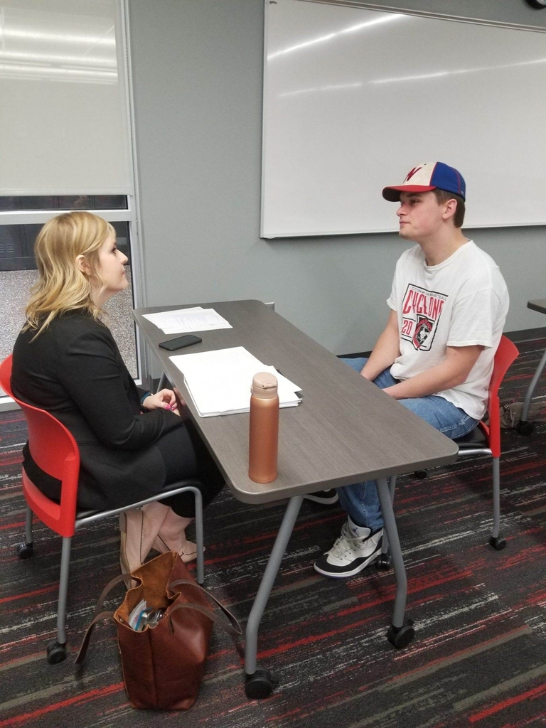 Student sitting at a desk participating in a mock interview