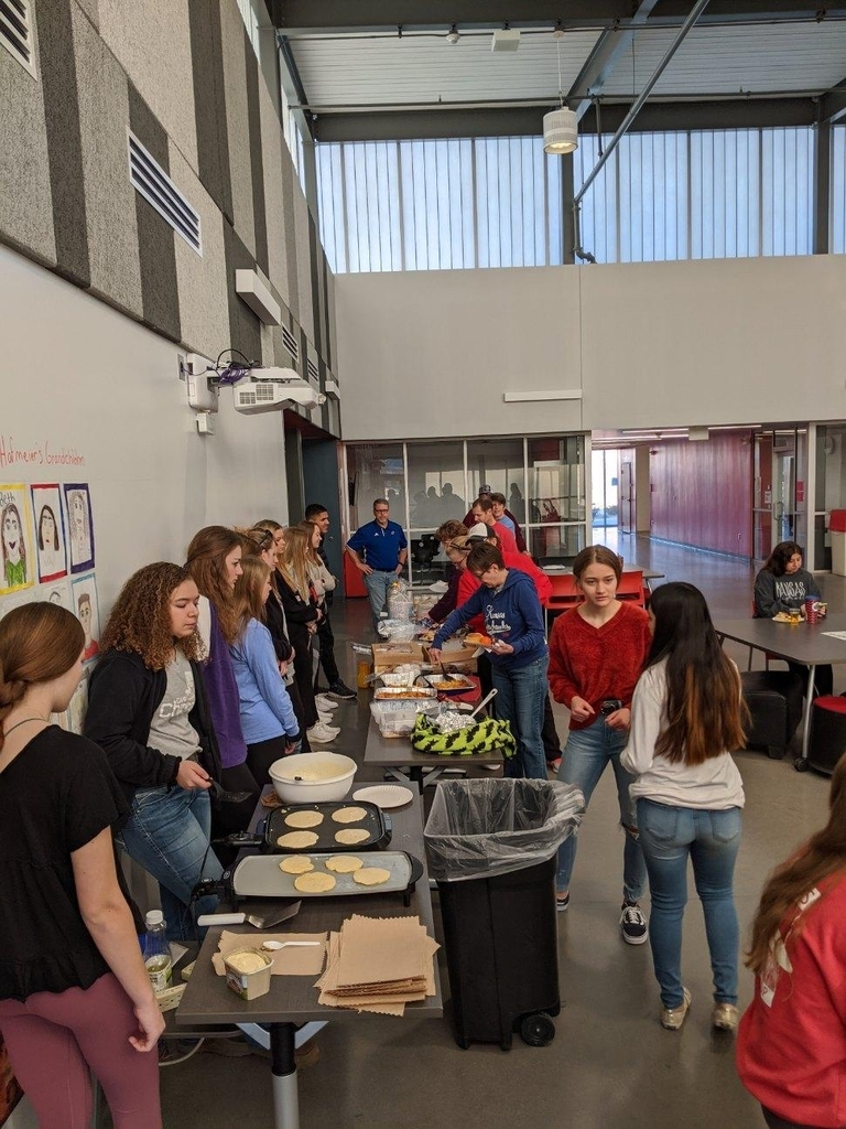 Students serving breakfast to teachers