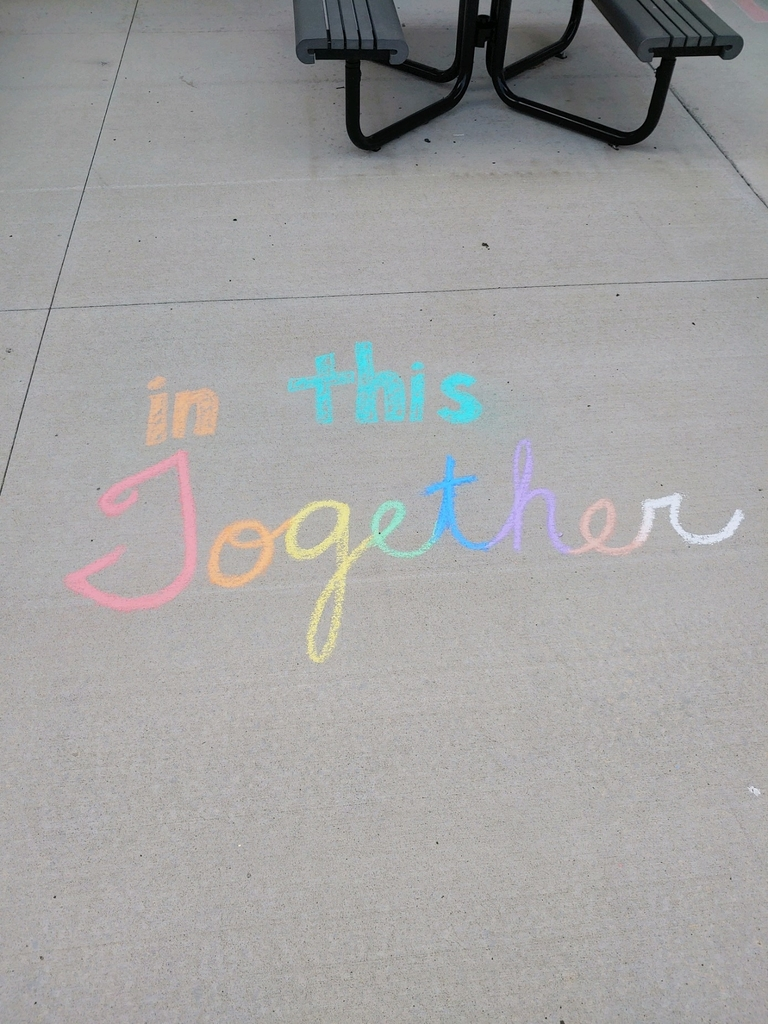 Chalk writing on a sidewalk