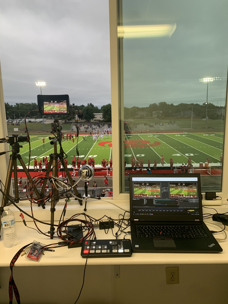 Computer and camera set up to live stream a football game